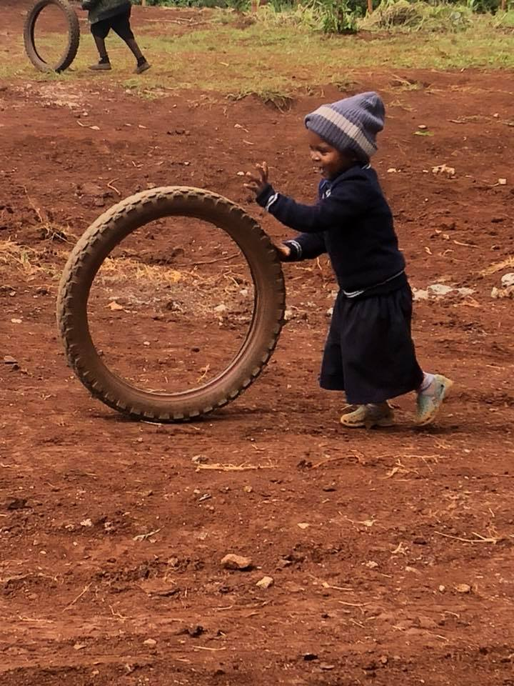 little girl with tire.jpg